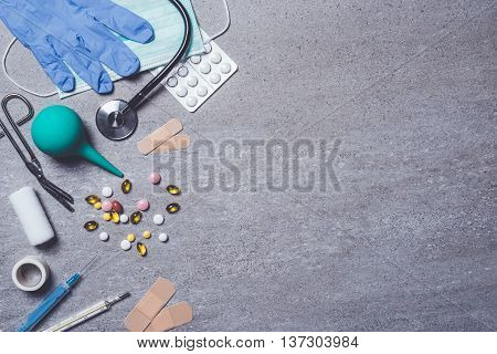 Medical supplies on stone background. Close up
