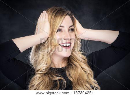 Cheerful Amazed Blonde Woman On Dark Background.