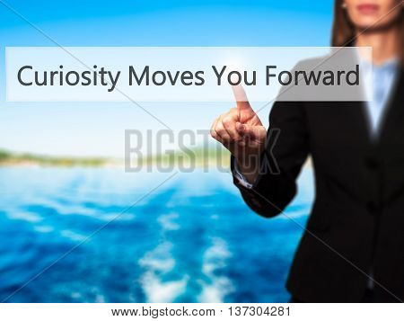 Curiosity Moves You Forward - Female Touching Virtual Button.