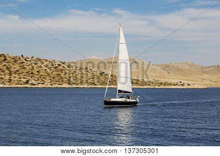 National Park Kornati islandsa and sailboat at sea in national park