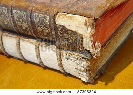 Antique broken books over a yellow background. Literature. Horizontal