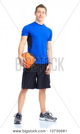 Smiling young strong  man with a basketball ball.  Isolated over white background