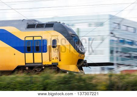 High speed train with motion blur effect summer time