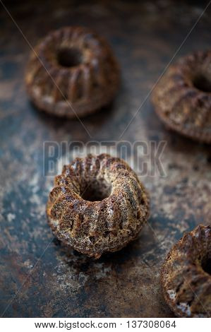 Mini chocolate bundt cake on a metal tray