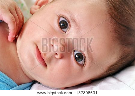 Beautiful and happy baby boy close up portrait.