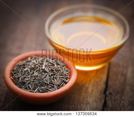 Caraway seeds with essential oil in glass bowl