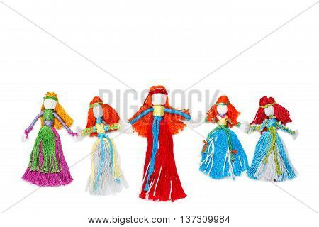 Handmade dolls holding hands on white. Family mother and daughter friendship concept