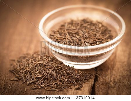 Close up of Caraway seeds in a glass bowl