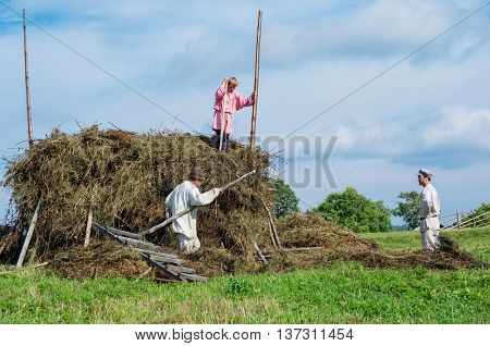People In National Costumes Work In The Field On The Island Kizhi, Rusia