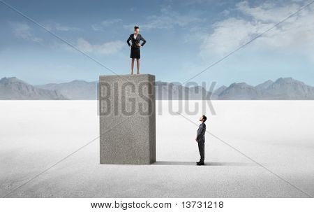 Businessman observing a businesswoman on a high cube