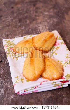 Madeleine cakes are the flower a towel.