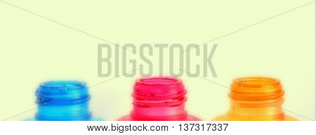 picture of an Empty Printer Ink bottle on White background Red Yellow Blue
