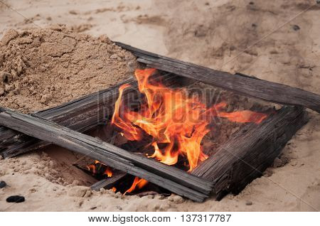 Bonfire. Fire in a sand pit. Flame