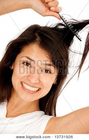 Desperate woman having a bad hair day - isolated over a white background