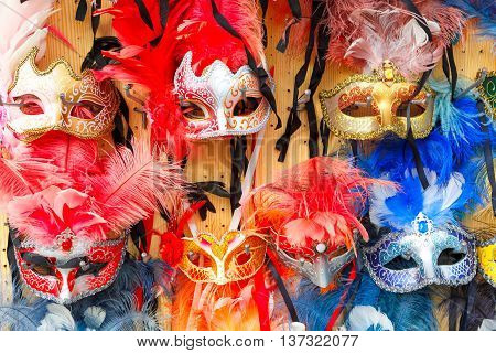Typical vintage venetian colored masks, symbol Annual carnival, in souvenir shop on a street of Venice, Veneto, Italy.