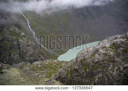 trift lake and suspended bridge in swiss alps