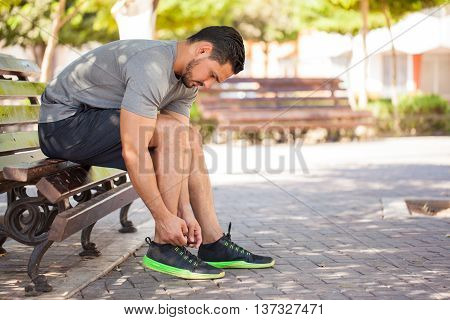 Male Runner Tying His Shoes Before Training
