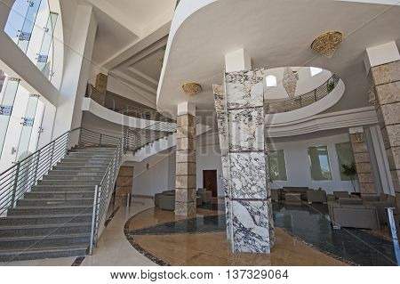 Interior design architecture of large luxury hotel lobby with marble columns