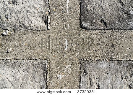 Horizontal crossed flag textured concrete wall background