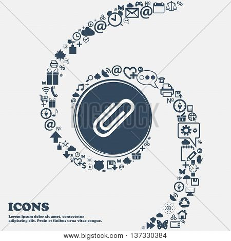Paper Clip Sign Icon. Clip Symbol In The Center. Around The Many Beautiful Symbols Twisted In A Spir