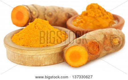 Turmeric with powder and mash over white background