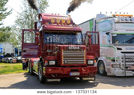 PORVOO, FINLAND - JULY 2, 2016: Classic bonneted red Scania 143H blows steam through exhaust pipes in Riverside Truck Meeting 2016.