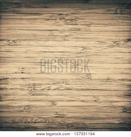Grunge scratched striped brown bamboo texture, cutting board with vignette.