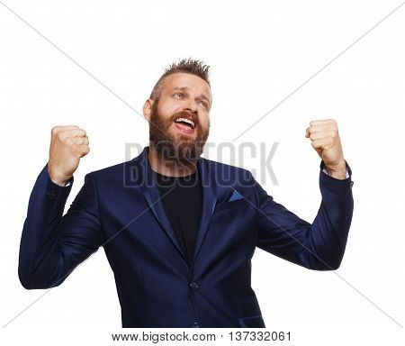 Lucky winner. Emotional man with beard in blue suit happy and joyful of his success. Portrait of bearded businessman isolated at white