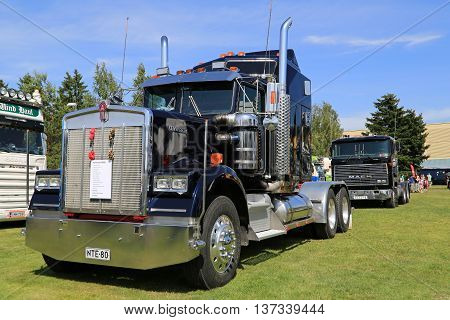 PORVOO, FINLAND - JULY 2, 2016: Dark blue Kenworth W900 truck tractor year 1982 on display on Riverside Truck Meeting 2016.