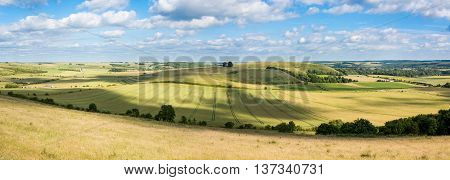 Middle Hill and Scratchbury Hill panorama. View from Battlesbury Hill with medieval strip lynchets on the edge of Salisbury Plain in Wiltshire UK