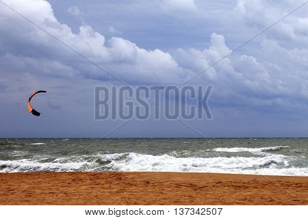 Power kite in sea and cloudy sky before rain