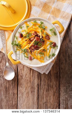 Potato Puree Soup With Bacon And Cheddar Close-up In A Pan. Vertical Top View