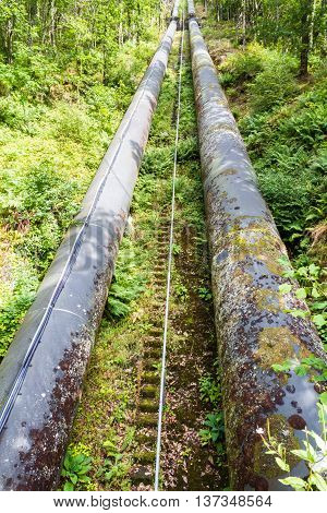 Two water pipes. The pipeline carries water from llyn or Lake Trawsfynydd to the Maentwrog hydro electric power station