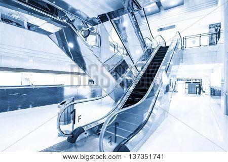 elegant escalator in modern shopping mall
