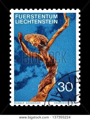LIECHTENSTEIN - CIRCA 1972 : Cancelled postage stamp printed by Liechtenstein, that shows wooden sculpture.
