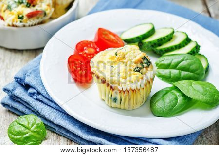 Bacon Spinach egg muffin on wooden background
