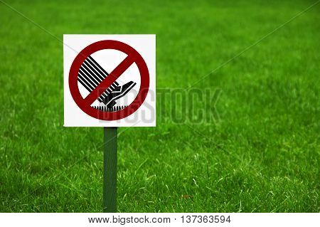 Forbidding sign on the lawn in the Park in the summer