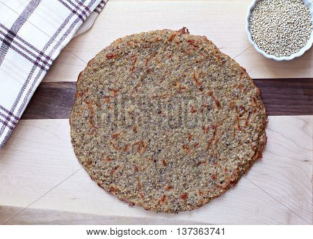 Homemade organic quinoa pizza crust baked and ready for your toppings.