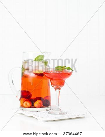 Delicious refreshing summer cocktail made with fresh cherries and peaches.