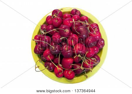 Top View of Pile of Bing Cherries in Green Bowl Isolated on white background