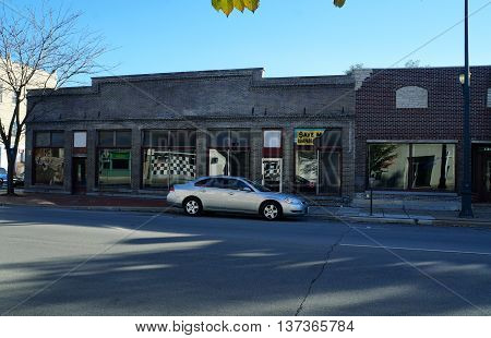JOLIET, ILLINOIS / UNITED STATES - NOVEMBER 1, 2015: A vacant brick building formerly housed a furniture store in downtown Joliet.