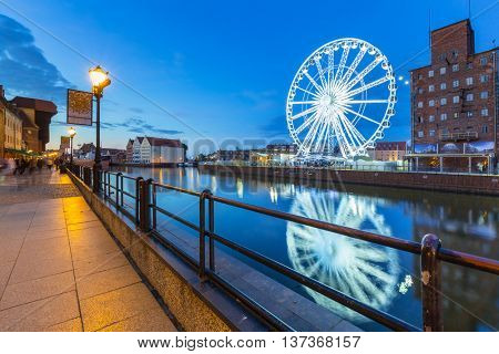 GDANSK, POLAND - 21 JUNE 2016: Ferris wheel in the city centre of Gdansk at night. Gdansk is the historical capital of Polish Pomerania with medieval old town architecture.