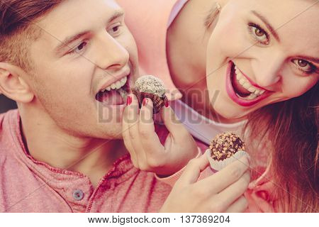 Smiling Couple Feeding Each Other.