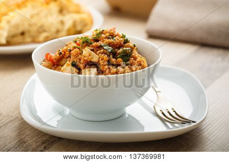 tabbouleh made of quinoa and various vegetables.