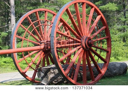 Wagon wheels red logging forest sun log