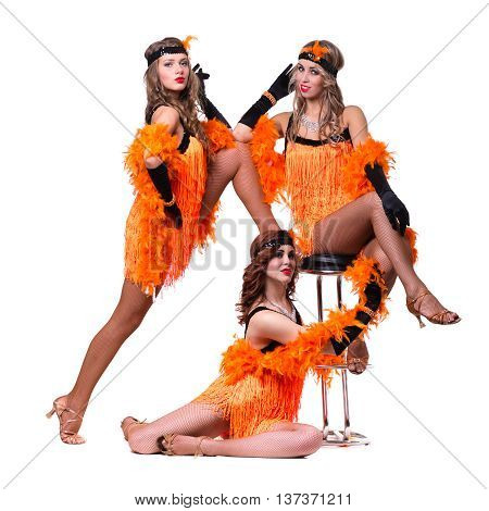 Female retro dancers showing some movements against isolated white background in full length