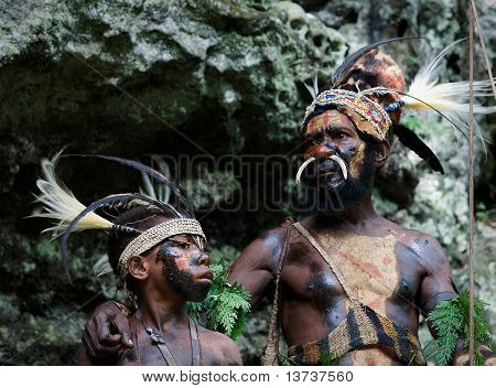 The Leader and young boy of a Papuan tribe of Yafi .