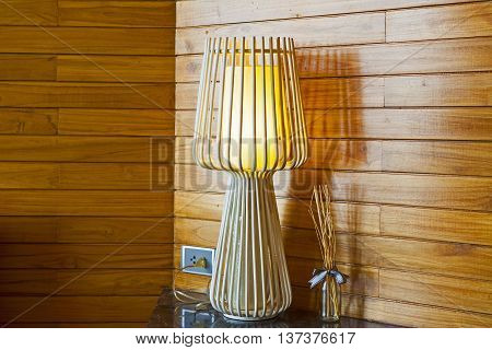 The interior of a bedroom with a lamp.