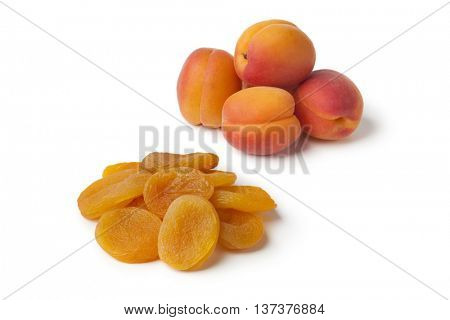 Heap of healthy nutritious fresh and dried apricot fruit on white background
