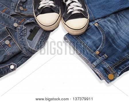 Sneaker shoe and fashionable jean denims isolated on white background.